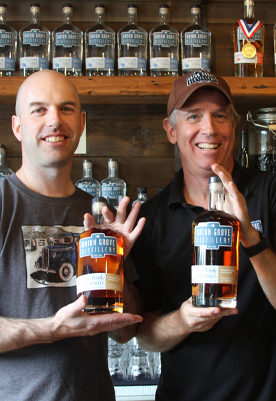 Union Grove Distillery Owners holding two bottles of Rye