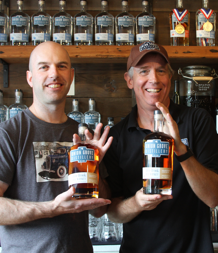 Union Grove Distillery Owners holding up their whiskey