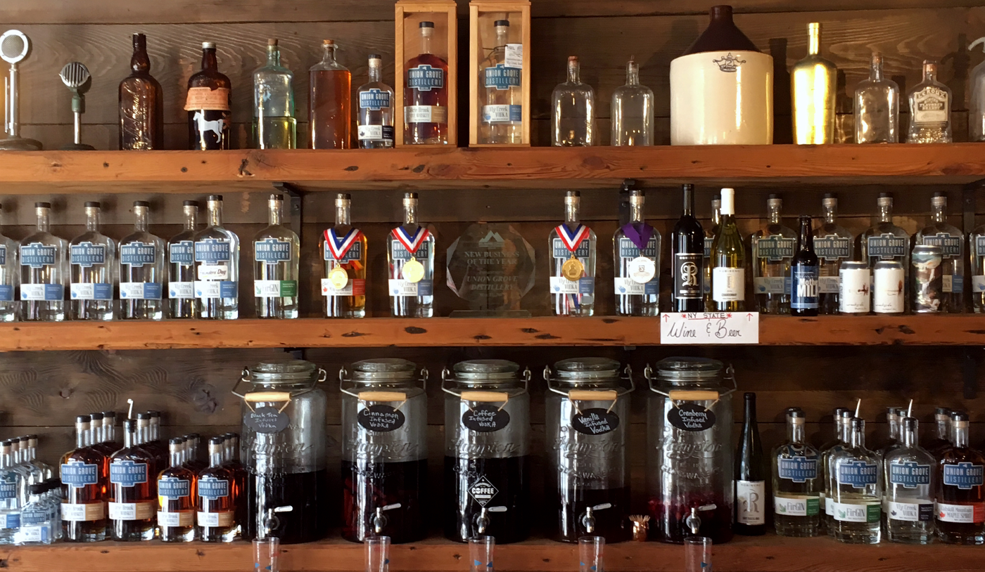 The back of the Union Grove Distillery bar with all their products